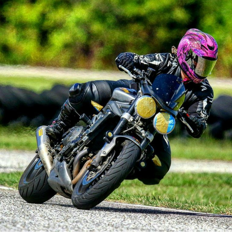 Brittany Morrow the Roadrash Queen Riding Her Triumph Street Triple R Motorcycle on the Racetrack wearing Icon Motosports Helmet